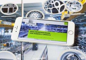 Die responsive Website der Hober & Driesch GmbH ist auf einem Smartphone geöffnet